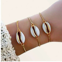 Nuovo stile di moda all'ingrosso colore genuino braccialetto conchiglia ciprea in regolabile 1 braccialetto a catena moda per le donne