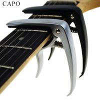 Nueva guitarra acústica y guitarra eléctrica capo plata y negro modelos opcionales de aluminio guitarra partes Accesorios