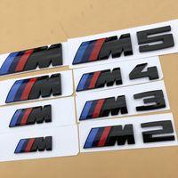 1PCS أسود لماع 3D ABS /// M M2 M3 M4 M5 كروم شعار السيارة التصميم الحاجز جذع شارة ملصق شعار لBMW الجودة جيدة