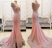 Pizzo cristalli in rilievo rosa Prom Dresses Sheer Neck Mermaid Back Covered Buttons Sweep Train Arabia Saudita Abiti da sera