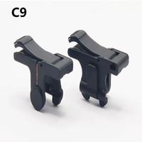 C9 E9 S4 D9 Botón de fuego móvil de 1 par Objetivo para PUBG Juego Reglas de juego de supervivencia Disparador Controlador de disparo L1R1 50PAIR / LOT