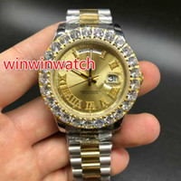 Two tone prongset bezel watch gold face diamonds Roman numbe...