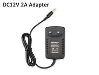 A CC 12V 2A conduziu o diodo emissor de luz da fonte de alimentação do interruptor da fonte de alimentação da UE da tomada do plugue O motorista 2835 SMD 5630 SMD 5050SMD conduziu a luz de tira do RGB