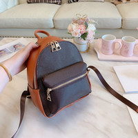 22 27cm Classic printing flower shoulder backpack Punk style Women's genuine leather ladies bags fashion large capacity backpacks