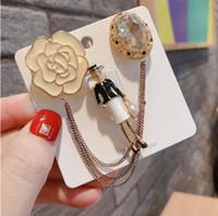 Корейский мода брошь оригинальные многоцелевые жемчужные камелия женский кисточкой стиль пинги пряжки значок брошь