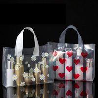 50pcs / lot amor regalo bolsa transparente de plástico almacenaje de la ropa Bolsa de la compra con la manija del banquete de boda de plástico de caramelo de la torta de embalaje Bolsas