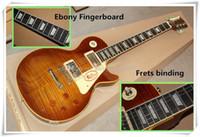 Nuevo Promoción de fábrica ébano trastes de unión de la guitarra eléctrica con la llama de chapa de madera de arce, puente fijo, se puede personalizar