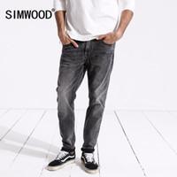 Jeans masculinos simwood chega 2021 primavera homens moda vintage magro fit casual denim calças de denim mais tamanho 180315