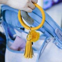 Bracelet en cuir PU Anneaux de clés Pompom Charm Bangle Clé Tassel Bague Circle Porte-clés pour Femmes Filles Bracelet Keytlet Bijoux Bijoux Cadeaux