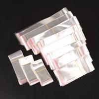 100pcs / lot trasparente autoadesivo sigillo sacchetto di plastica sacchetto del sacchetto di plastica del partito del partito dell'imballaggio dei sacchetti di stoccaggio dei bagagli