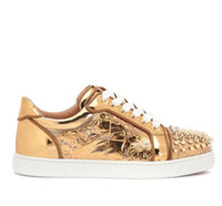 Elegant low- top style gold upholstered leather vieira spikes...