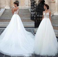 Vestidos De Novia Vestidos de novia de encaje Cuello transparente Apliques Una línea Vintage Vestidos de novia con botones cubiertos Volver Vestidos de novia BC2542