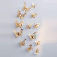 12pcs / set pared de la mariposa pegatinas Hollow extraíbles papel pintado del mural del arte etiquetas de la pared 3D para el dormitorio sala de estar decoración del hogar