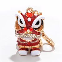 Festival chinois cristal rotatif danse du lion hommes voiture porte-clé chanceux éléphant porte-clés anneau femmes sacs titulaire charme