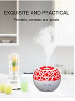 Compact and gentle orange aroma humidifier used in dry weath...