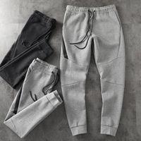 2019 New Mens Designer Tech Fleece Sport Pantalones Pantalones Hip Hip Streetwear Men's Sport Marca Espacio Cotton Pantalones Tamaño: M-XXL