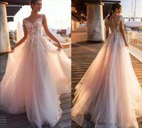 Blush Pink A Line Свадебные платья 2020 Cap Короткие рукава Sheer шеи Иллюзия кнопки Назад Кружева Аппликации Свадебные платья Пляжные свадебные платья 7
