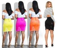 Weibliche aushöhlen Quasten Röcke Unregelmäßige Kleidung mit Reißverschluss Frauen Paket-Hüfte-Jeansröcke Sommer