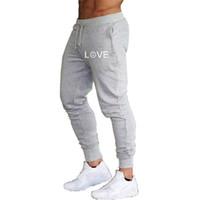 Pantaloni pantaloni AMORE Trend di sport degli uomini Pantaloni felpati correnti di sport Piedi sottile casuale pantaloni fascio Bocca