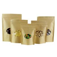 100pcs Kraft Brown Standing Zip Block Bag di imballaggio con finestre ovali Cancella dadi richiudibili e confezione da imballaggio cerata sacchetti di stoccaggio di cibo