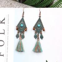 Moda retrò diamante orecchini femminile transfrontaliera legno paraorecchie lungo nappa stile di vendita calda accessori perline all'ingrosso
