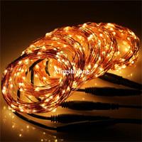 Hot 33Ft 10M 100LED Luces de la secuencia del alambre de cobre Luces de hadas para el Año Nuevo al aire libre Decoración del banquete de boda de Navidad 12V DC Adaptador de corriente incluido