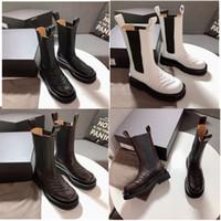 مصمم أحذية النساء الأزياء والأحذية والجلود حقيقي منتصف الساق الأحذية في STORM CUIR النساء الفاخرة منصة الحذاء العلامة التجارية أصابع مربع سيدة الأحذية