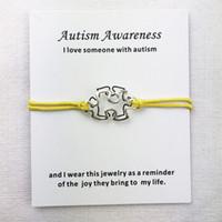 10pcs / lot incanta il consapevolezza autismo Cuff Multilayer Red corda della cera monili dei braccialetti con il braccialetto della carta d'argento antico delle donne degli uomini unisex