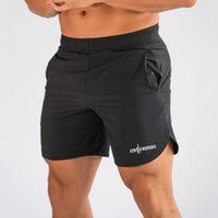 New Quick Dry Running Shorts Men Solid Sports Training Clothing Fitness Bodybuilding Short Pants Sport Homme Gym Shorts Beach