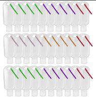 أفضل 30ML / 50ML / 60ML سفر البلاستيك البلاستيك لوحة مطهر يد المفاتيح واضحة، زجاجات فارغة إعادة الملء حاويات الضغط المحمولة مع غطاء الوجه