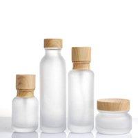 Замороженные стеклянные банку кремовые бутылки круглые косметические баночки для болота для лапки для болота насоса с деревянной зерновой крышкой