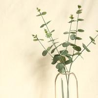 نباتات اصطناعية 65CM محاكاة الكافور الخضرة والزهور أوراق شجرة الكينا الزفاف الديكورات المنزلية atificial خضرة النباتات وهمية