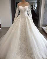 Lyxiga Långärmade Lace Appliqued A-Line Bröllopsklänning med Sheer Back Vintage Saudiarabien Dubai Juvel Neck Plus Storlek Brudklänning