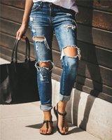 Frauen reizvolles Loch Bleistift-Jeans Sommer Designer Damen gebleichter Knopf dünne dünne Hosen Frauen Licht gewaschener Vintage Hose