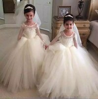 2020 Vestidos de concursos de chicas de tul blanco con pura joya Cuello de cordón Applique Illusion de manga larga vestido de bola de manga larga Ropa formal Vestido de niña