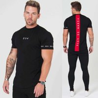 ジム服フィットネスティーメンファッションTシャツextensヒップホップ夏半袖Tシャツ綿ボディービルディング筋肉男