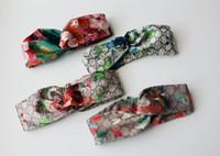 Luxusdesigner Elastische Stirnbänder für Frauen Klassische schicke echte Seide weiche SIL-Blume Haarbänder für Damen Mädchen Retro Turban Headwrapps 4Clours
