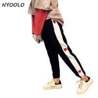 Nyoolo New Streetwear Primavera Outono Amor Bordado Costura Mid Elastic Cintura Hip-hop Longo Lápis Calças Mulheres / homens Calças Y19070101