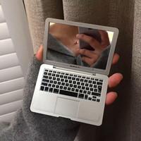 Mac Mini Espejo Espejo portable creativo de Apple Notebook Forma portátil plegable pequeño espejo de maquillaje de febrero de 13 terminado