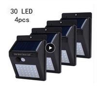 Светодиодные фонари на солнечных батареях Солнечный настенный светильник 30 светодиодов PIR Motion Sensor Солнечные фонари Открытый Водонепроницаемый Украшение сада Лампы 4 шт.