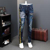 Осенние Дырки патч джинсы Мужчины Упругие Tiger Head Свободное время Tide Brand Дизайнерские джинсы Длинные брюки вышивка Печать Tide CX200701