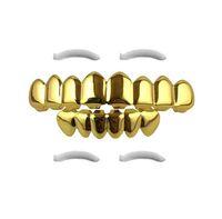 Hip Hop Gold Grillz 2019 New Fashion Ambiental Chapado en oro Parrillas dentales al por mayor Halloween Dientes tirantes Juego de 2 piezas