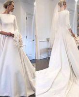 2019 Modeste robes de mariée en satin Meghan Markle style cou Manches longues Bateau couvert PRÉCÉDENT Jardin Robe de mariée