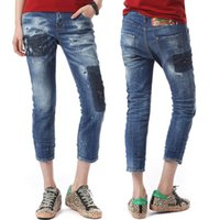 Pantalones vaqueros desgastados para mujer Ripped Knee Zipper Hem Fade Wash Effect Denim Pencil Pants Ladies Hot Sale