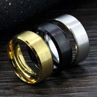 Großhandels100pcs / Lot Silber / Gold / Schwarz Band Mens-Edelstahl-Schmuck Ringe