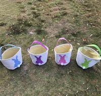Pascua Conejo Cesta de Pascua Bolsos de conejito de Pascua Conejo Impreso lienzo Bolsa de asas Egg Dulies Cestas 50pcs L-OA3960