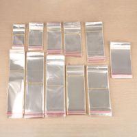 Guarnizione autoadesiva trasparente OPP OPP Plastica Borse per cellophane Regali Bagpouch Gioielli Borsa da imballaggio con foro di appendere 500pcs