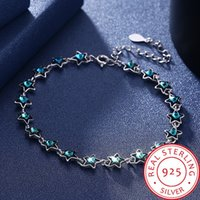 A row of blue crystal star girl romantic 925 sterling silver...