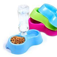 Tazón de plástico de doble uso para perros Cuadrícula para mascotas Jaula Tazones dobles para cachorros Gato Bebida automática de agua Tazones Alimentador de alimentos Alimentador de perros