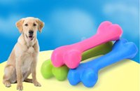 Perro Juguetes resistente a la mordedura de perro de perrito del hueso Molares Rubber Ball Juego para dientes Formación térmica de goma de plástico juguetes para mascotas 12 * 4cm de DHL